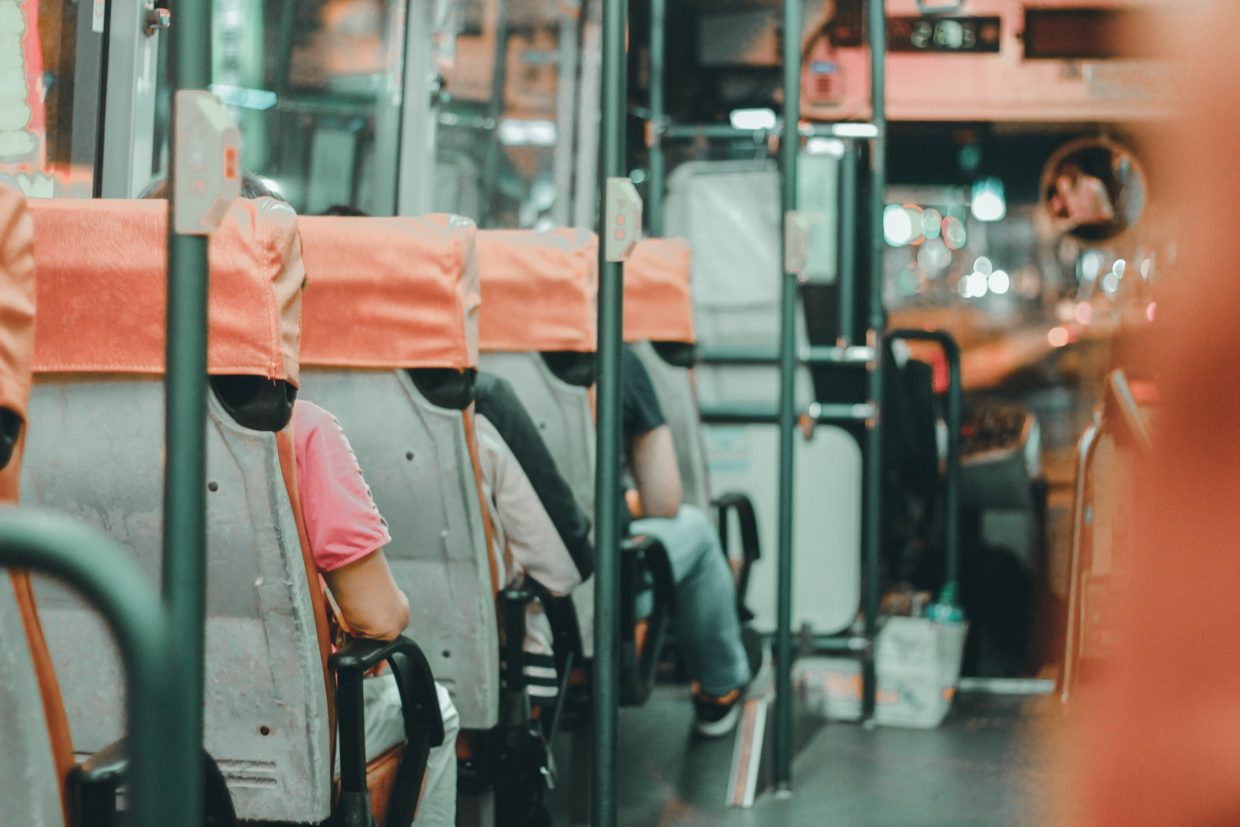 people sitting on bus seats